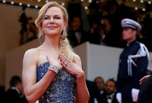 Nicole Kidman poses on the red carpet as she arrives for the opening ceremony and the screening of the film
