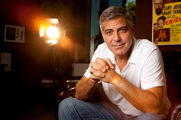 George Clooney: she looks at me confused, about my sense of style and at times she says 'are you going to wear that tequila t-shirt again?'