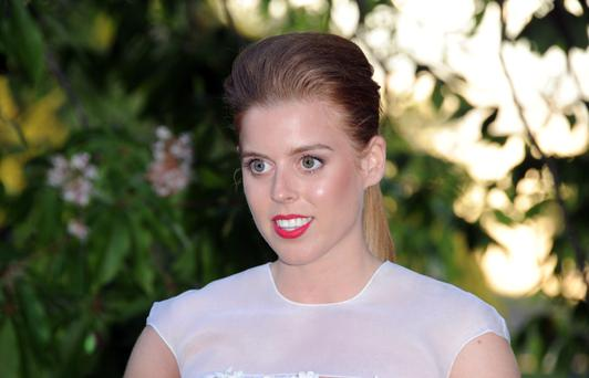Family matters: Princess Beatrice at a summer party in London last week.
