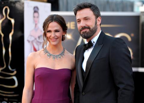 Uncoupling: Jennifer Garner and Ben Afflek at the 2013 Oscars where Ben mused that married life was like 'work, the best kind of work'.