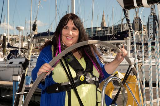 Oh buoy! Andrea Smith at the helm of the Jigamere cruiser boat in Dun Laoghaire. Photo: Arthur Carron