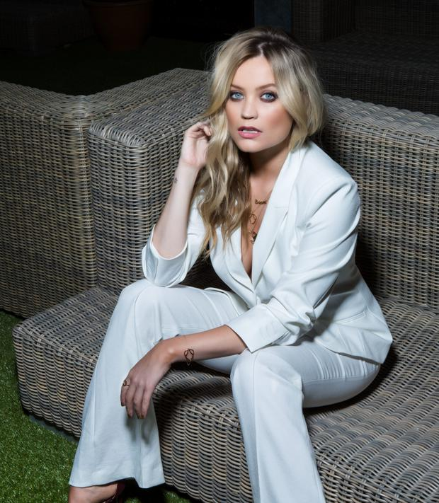 Blonde on the run: Laura Whitmore wears - Suit; shoes, River Island. Photo: Kip Carroll.