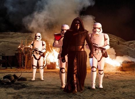'This will be a day long remembered': Kylo Ren played by Adam Driver accompanied by Stormtroopers. The movie opens next week