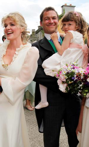Family man: Catherine Fitzgerald and Dominic West with their children on their wedding day in Limerick in 2010
