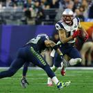 Get to the end zone: Julian Edelman of the New England Patriots and Earl Thomas of the Seattle Seahawks during Super Bowl 2015