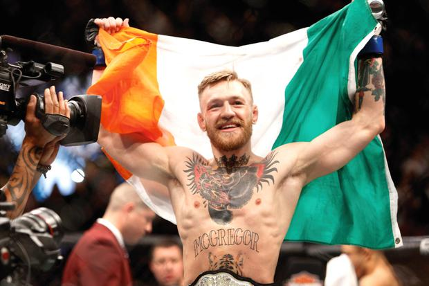 McGregor parading the tricolour after his infamous Las Vegas first-round knockout victory over Jose Aldo in their UFC featherweight title fight last December.