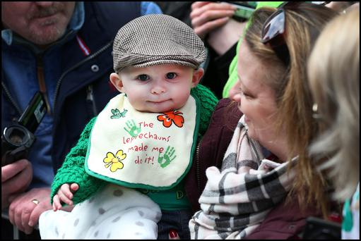 James Kerr (five months) and his mother Nikki Kerr from Omagh, Co Tyrone, watching the parade. Photo: Steve Humphreys