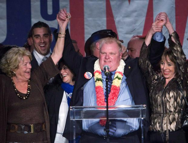 CONTROVERSIAL: Rob Ford with his wife Renata, right, speaking to supporters in Toronto. Ford died on Tuesday, following a battle with cancer. Photo: AP