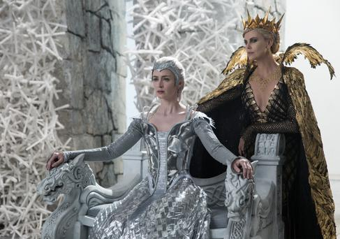 Sister act: Emily Blunt and her on-screen sibling Charlize Theron in 'The Huntsman: Winter's War'
