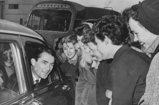 The good guy: Gregory Peck chats to a group of young fans in Copenhagen in 1953. Photo: Keystone/Hulton Archive/Getty Images.
