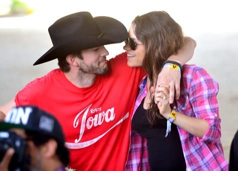 Ashton Kutcher with his wife Mila Kunis. They met when they were filming sitcom 'That '70s Show'.