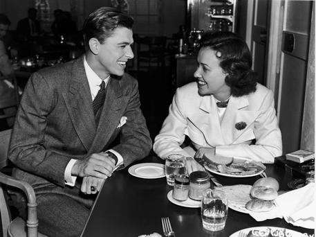 Young star: Reagan chats with fellow actor Margaret Lindsay in a Warner Brothers shot from 1935