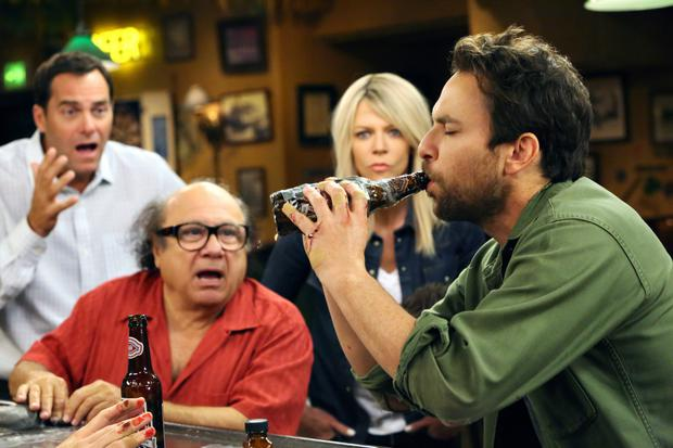 Danny De Vito (right) cheers on a pal in a drinking game in eposide one of season 11 'It's Always Sunny in Philadelphia'.