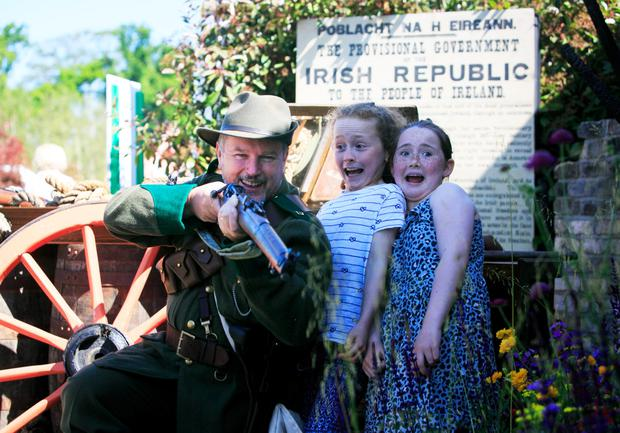 Tola Collier with Emily Morgan (10) and Hollie Nixon (10), from Oristown, Kells, at the Bullets and Boiled Sweets 1916 Commemoration Garden. Photo: Gareth Chaney