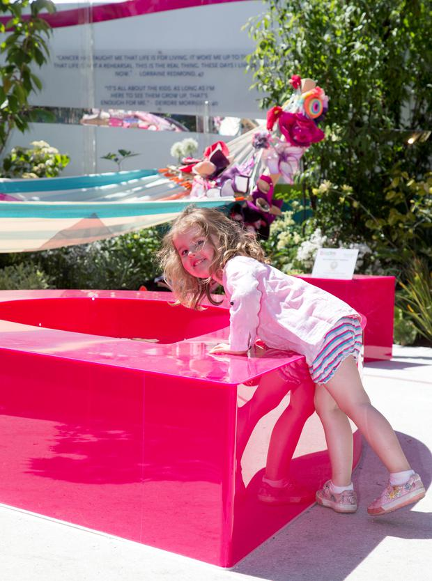Rachel Graham in the Marie Keating Foundation's bright pink 'Garden of Hope'. Photo: Colin O'Riordan