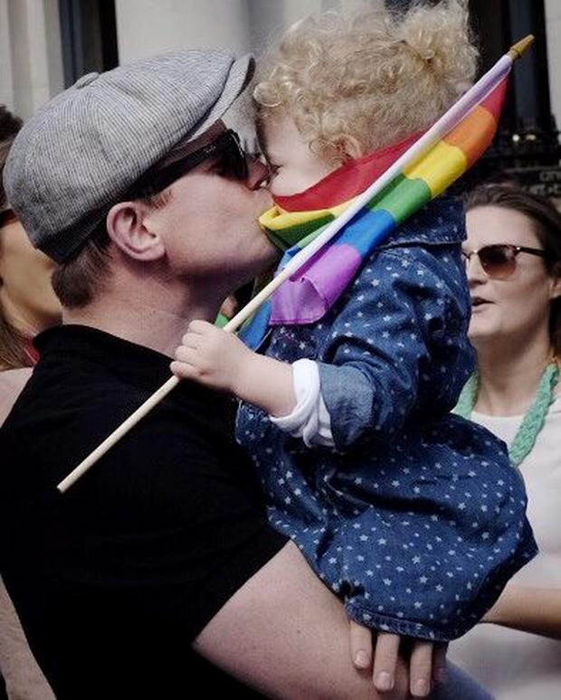 Amy's husband Brian O'Driscoll with their daughter Sadie outside Dublin Castle celebrating the yes result in Ireland's same sex marriage referendum last year. Photo: El Keegan