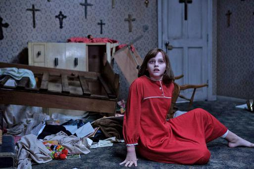 Spooked: Madison Wolfe, playing Janet Hodgson, is haunted by spirits in 'The Conjuring 2', based on the real-life events of the Enfield Haunting.
