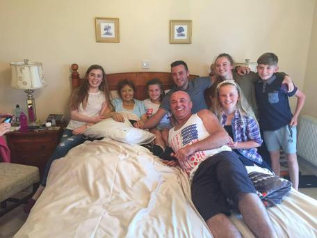 Máire surrounded by friends and family as Nathan Carter performs by her bedside. Photo: Facebook