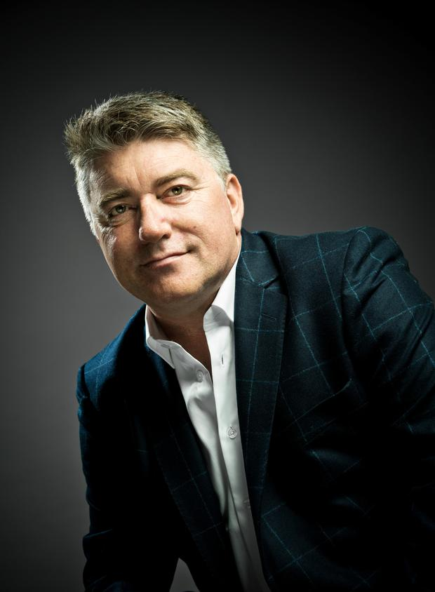 Pat Shortt wears: Dillon check blazer, €369; white shirt, €99; trousers, €99. All clothing from Arnotts, arnotts.ie. Photo: Mark Nixon