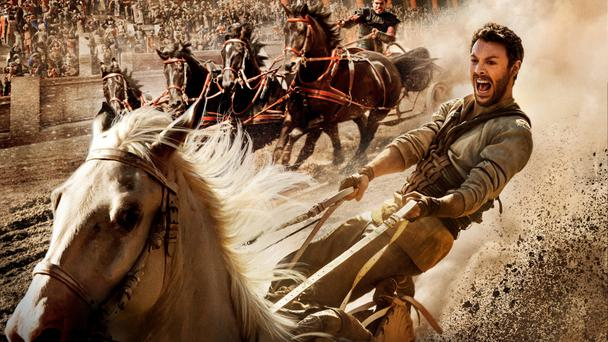 Taking the reins: Jack Huston wrestles for control during the chariot race scene in a remake of Ben-Hur