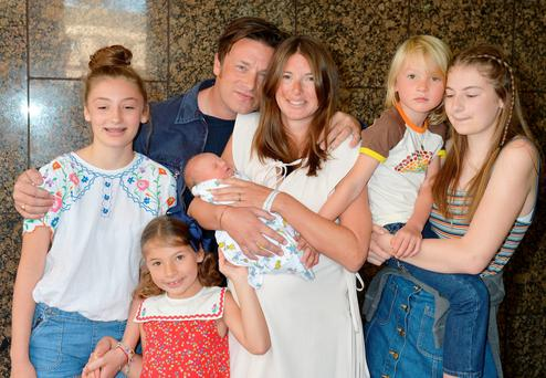 Jamie and Jools Oliver with their family, including the new addition, River Rocket