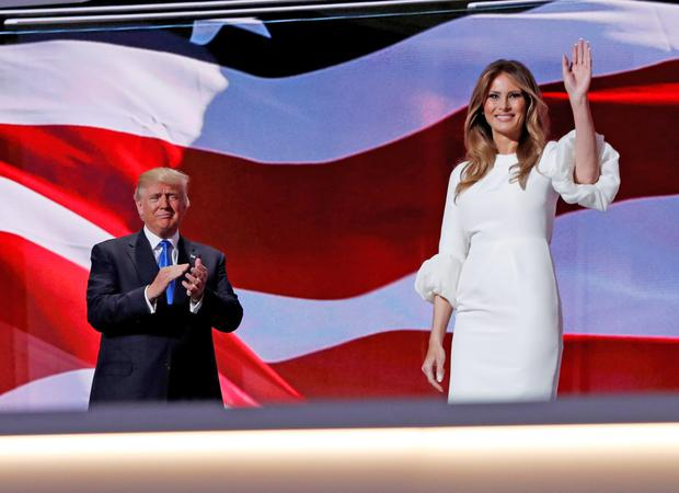 Melania Trump waves to delegates at the Republican National Convention in July as husband Donald looks on