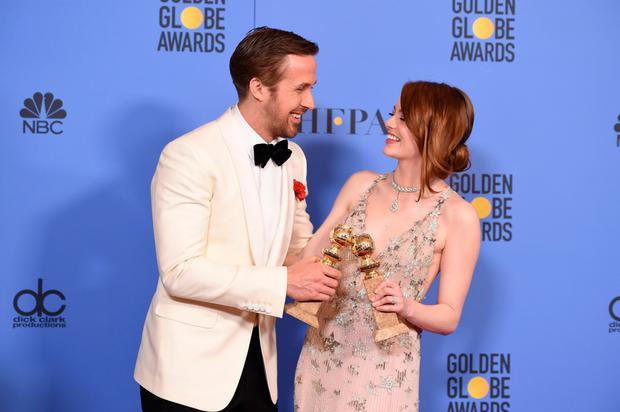 Golden boy: Ryan Gosling, seen here with La La Land co-star Emma Stone, paid a glowing tribute to his wife