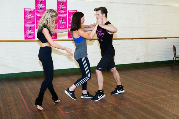 Writer Jennifer O'Brien (centre) learns a routine from Dirty Dancing from the cast of the stage show Carlie Milner (Penny) and Lewis Griffiths (Johnny) Photo Francesa Emma Photograpy