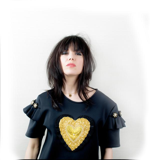 Neoprene T-Shirt by Natalie B Coleman at Made Store, Powerscourt, Dublin. 'Hot Tramp' Gold Plectrum necklace by Laura Whitmore x Daisy, daisyjewellery.com