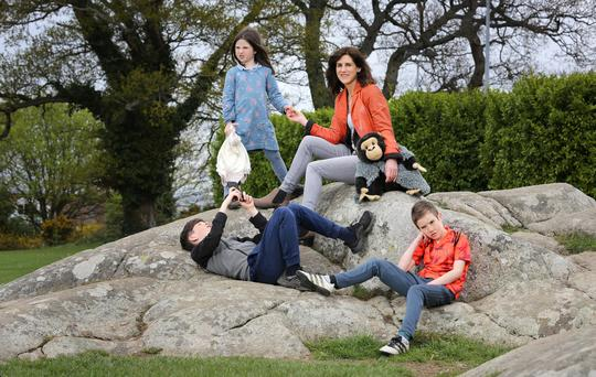 Emily Hourican pictured with her three children, Bee [6] , Malachy [13], Davy [9], and Jamie the monkey, in Deerpark, Stillorgan. Photo: Frank Mc Grath