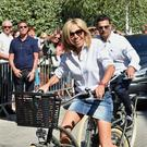Breaking the rules: Brigitte Trogneux flaunts her great legs in a mini