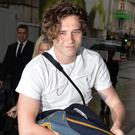 Brooklyn Beckham supported by parents Victoria and David at book event (John Stillwell/PA)