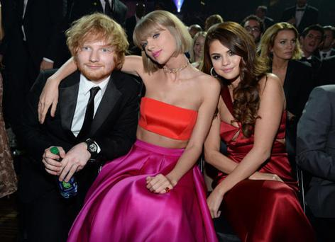 Ed Sheeran with Taylor Swift and Selena Gomez at the Grammy Awards last year