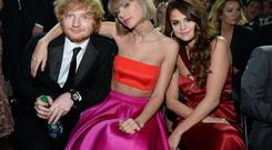 Ed Sheeran with Taylor Swift and Selena Gomez at the Grammy Awards last year. Photo: Getty