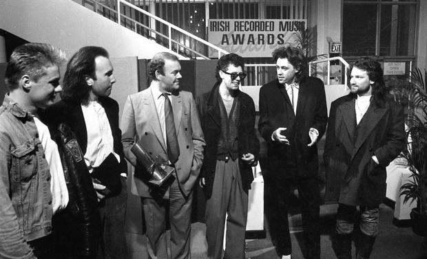Larry Mullen Jr, The Edge, Paul McGuinness, Adam Clayton, Bob Geldof (Boomtown Rats) and Bono back stage at the 1986 Milk Music Awards in the National Concert Hall. Photograph: Irish Independent Archives