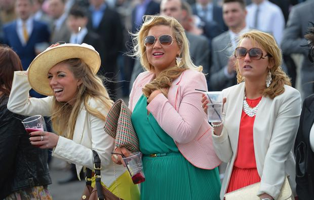 Dressed for the occasion: the girls at Aintree Ladies Day have the right attitude. Getty