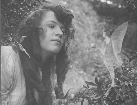 Elsie Wright with fairy offering a posy of harebells. Photo: Getty Images