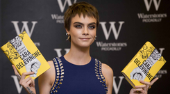 The write stuff: Cara Delevingne promotes her new book Mirror Mirror. Photo: Getty Images