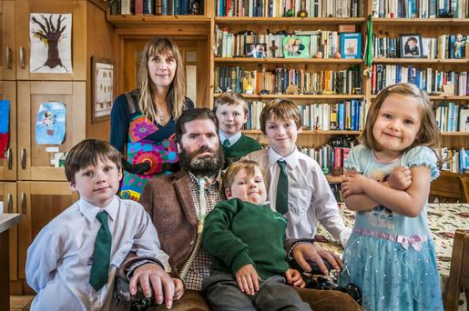 Vivid portrait: Simon, seen here with wife Ruth and their five children. Photo: Marc Atkins