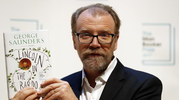 Author George Saunders with his book Lincoln In The Bardo