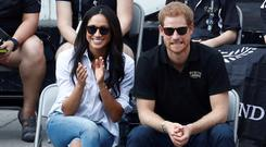 It's in the jeans: Meghan wore ripped jeans on their first public outing. Photo: REUTERS