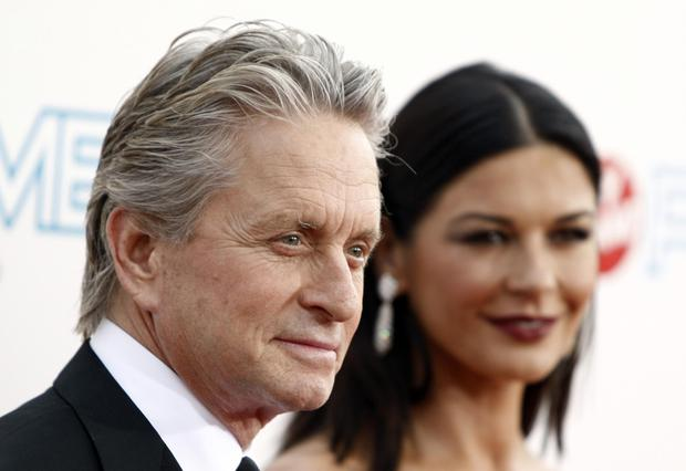 Michael Douglas, pictured with his wife Catherine Zeta-Jones, said the accusation is a 'complete lie'. Photo: AP