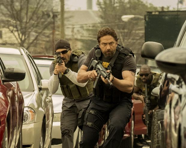 Daylight robbery: Gerard Butler overacts in Heat rip-off Den of Thieves. Photo: STX Entertainm