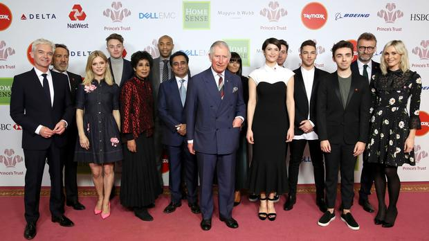 Charles, centre, with ambassadors and supporters of his Prince's Trust during the charity's 2017 Prince's Trust Celebrate Success Awards at the London Palladium (Chris Jackson/PA)