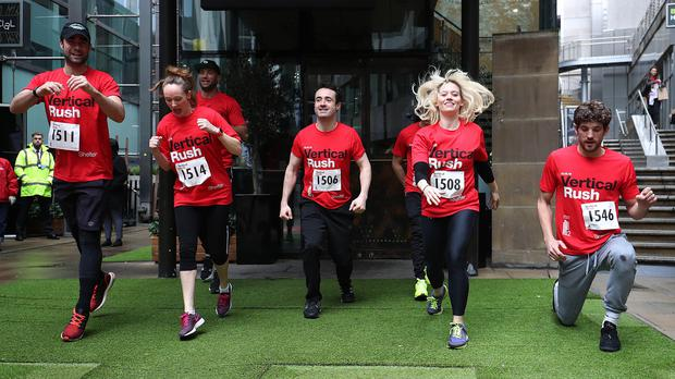 Celebrities warm up before taking part in the Vertical Rush by racing up the 932 steps to the top of Tower 42 in London, to raise money for Shelter (Jonathan Brady/PA)