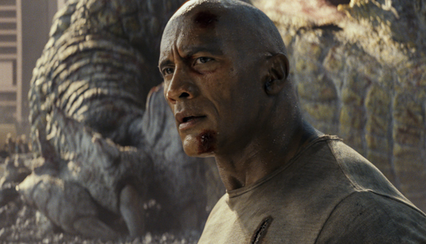 Simply the beast: Dwayne Johnson repels a gator raid, a big bad wolf and a gorilla in Chicago. Photo: Warner Bros
