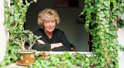 Nuala O Faolain gazing out the window of her home in 1997. Photo: Eamonn Farrell