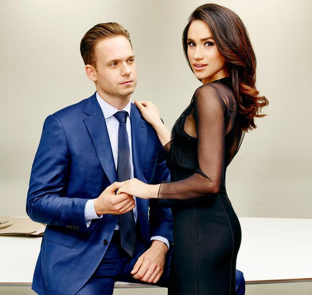 Law and ardour: Meghan Markle strikes a pose alongside on-screen boyfriend Patrick J Adams