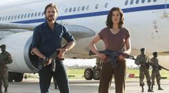 Terrorist cell: Daniel Bruhl and Rosamund Pike help hijack a plane in Entebbe
