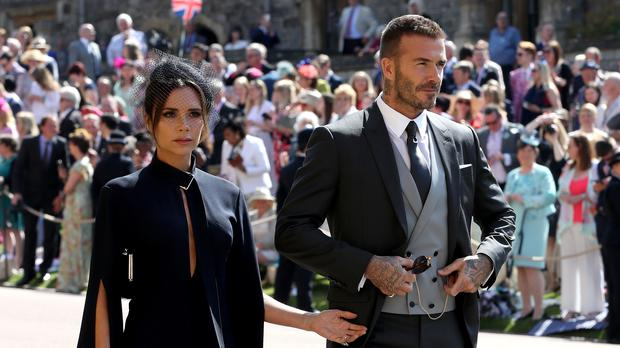 David and Victoria Beckham arrive at St George's Chapel (Chris Radburn/PA)
